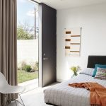 Concrete Floor, White Wall, Black Headboard, White Bedding, White Midcentury Modern Chair, Black Door, Large Glass Window