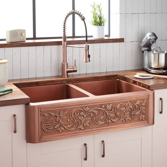 copper carved kitchen sink, white bottom cabinet, white vertical subway backsplash tiles