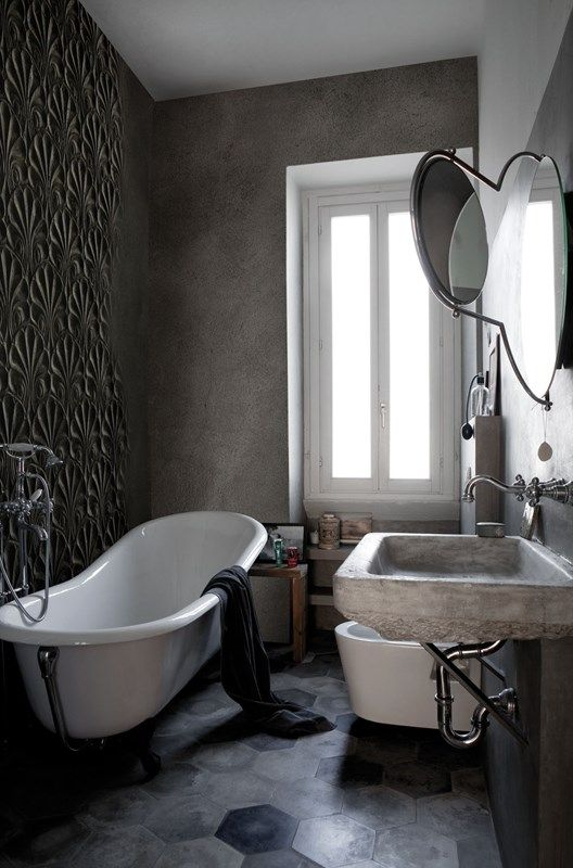 dark grey wall, detailed wall, floating concrete sink, grey hexagonal floor tiles, white framed window