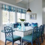 Dining Nook, Wooden Floor, White Wall, White Wooden Ceiling, White Bench, Blue Cushion, Blue Wooden Chairs With Gren Cushion, White Table, Glass Top, White Pendant