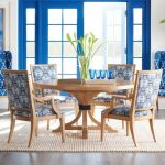 Dining Room, Brown Rattan Rug, Wooden Round Table, Wooden Chairs With White Blue Patterned Cushion, Blue Framed Door