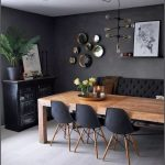 Dining Room, Grey Floor, Dark Grey Wall, Black Tufted Sofa, Black Midcentury Modern Chairs, Black Cabinet, Wooden Table, Glass Bulb Chandelier