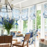 Dining Room, Large Glass Doors, White Floor, Wooden Chairs With Rattan Seat, Chandelier, White Wall, Vaulted Ceiling, Blue Patterned Curtain, Blue Patterned Chair