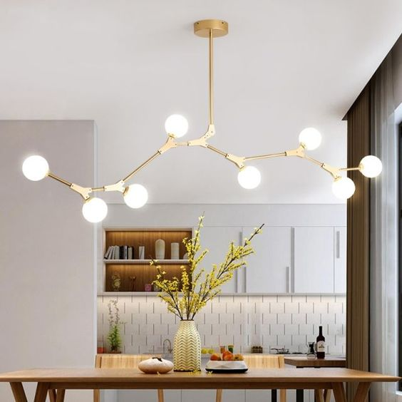 dining room, white wall, wooden table, golden lines with white bulbs, white upper cabinet, white backsplash