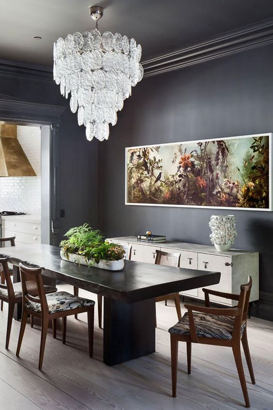 dining room, wooden floor, grey wall, white glass chandelier, white cabinet, black wooden dinign table, wooden chairs