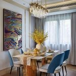 Dining Room, Wooden Herringbone Floor, White Wall, Long Crystal Chandelier, Blue White Chair, White Table With Golden Feet, White Curtain