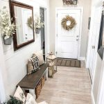 Entryway, Wooden Floor, White Shiplap, Dark Wooden Bench, White Wooden Door, Rattan Basket, Mirror