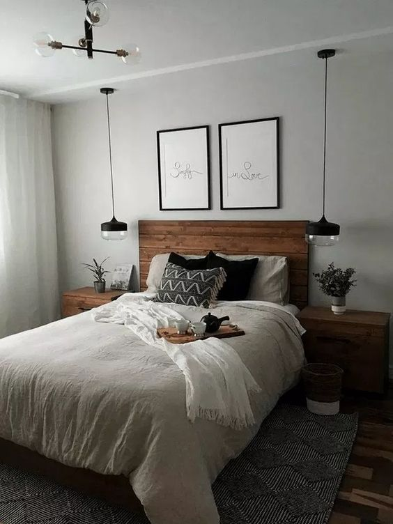 farmhouse bedroom, grey wall, glass pendant, wooden headboard, wooden side table, floor rug, glass chandelier, gey rug