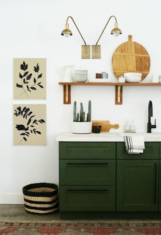 floating shelves, dark green bottom cabinet, white wall, white counter top, grey floor, red rug, sconces
