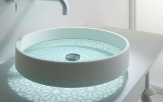 glass sink with flower pattern, white round frame, white faucet, white vanity, round mirror