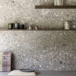 Grey Terrazzo Kitchen Wall, Floating Shelves, Grey Counter Top, White Bottom Cabinet