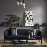 Grey Wall, Dark Blue Sofa, Wooden Floor, Black Rug, Black Round Coffee Table, White Pendant