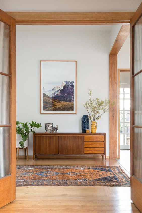hallway, wooden floor, pretty rug, white wal, wooden beams, wooden cabinet