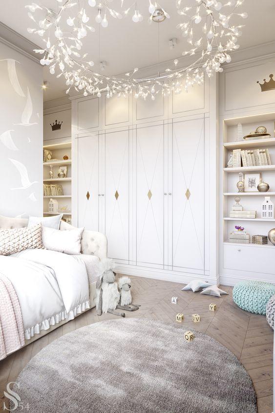 kids room, wooden chevron floor, white built in upboard and shelves, white bed, crystal pendant, round rug
