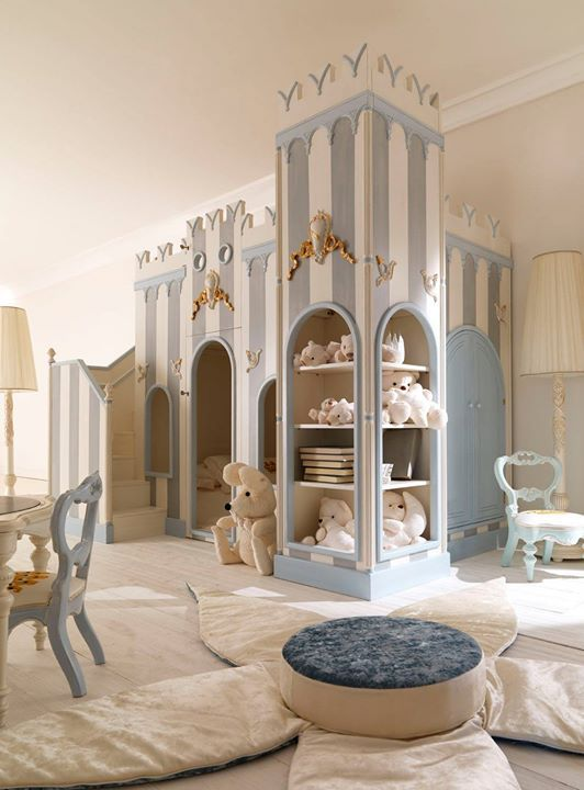 kids room, wooden floor, cream wall, blue cream  castle with shelves, flower table cushion, blue low chairs