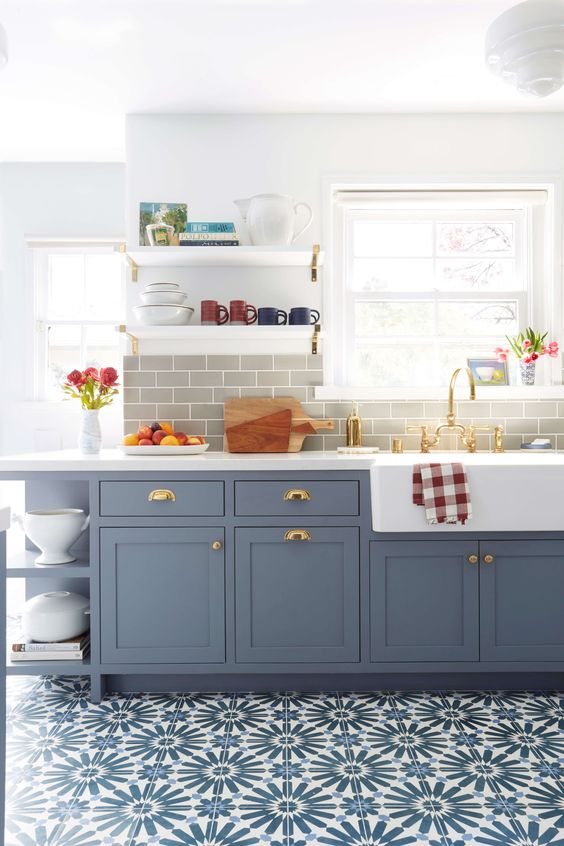 kitchen, blue white patterned floor, white wall, grey backsplash, light blue cabinet with white counter top