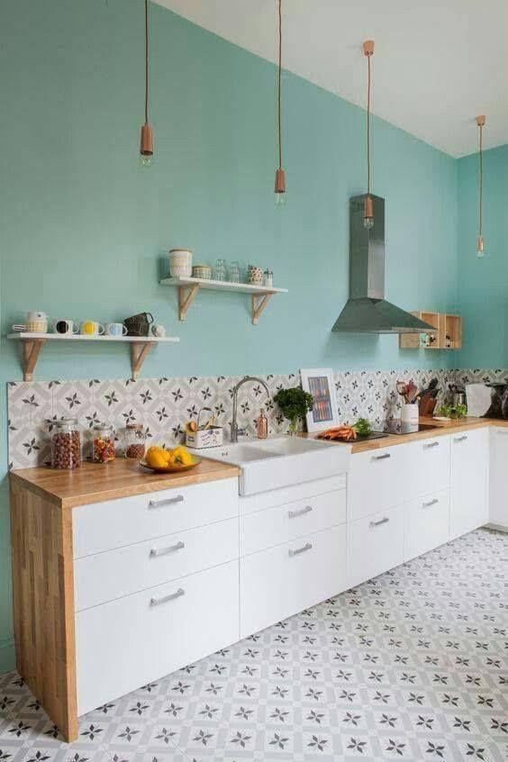 kitchen, bright light green, white bottom cabinet, patterned backsplash, patterned floor tiles, wooden counter top, long pendant