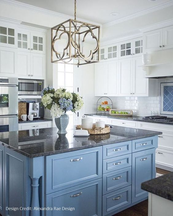 kitchen, dark marble floor, white cabinet, blue cabinet, white subway tiles, golden pendantm black marble counter top