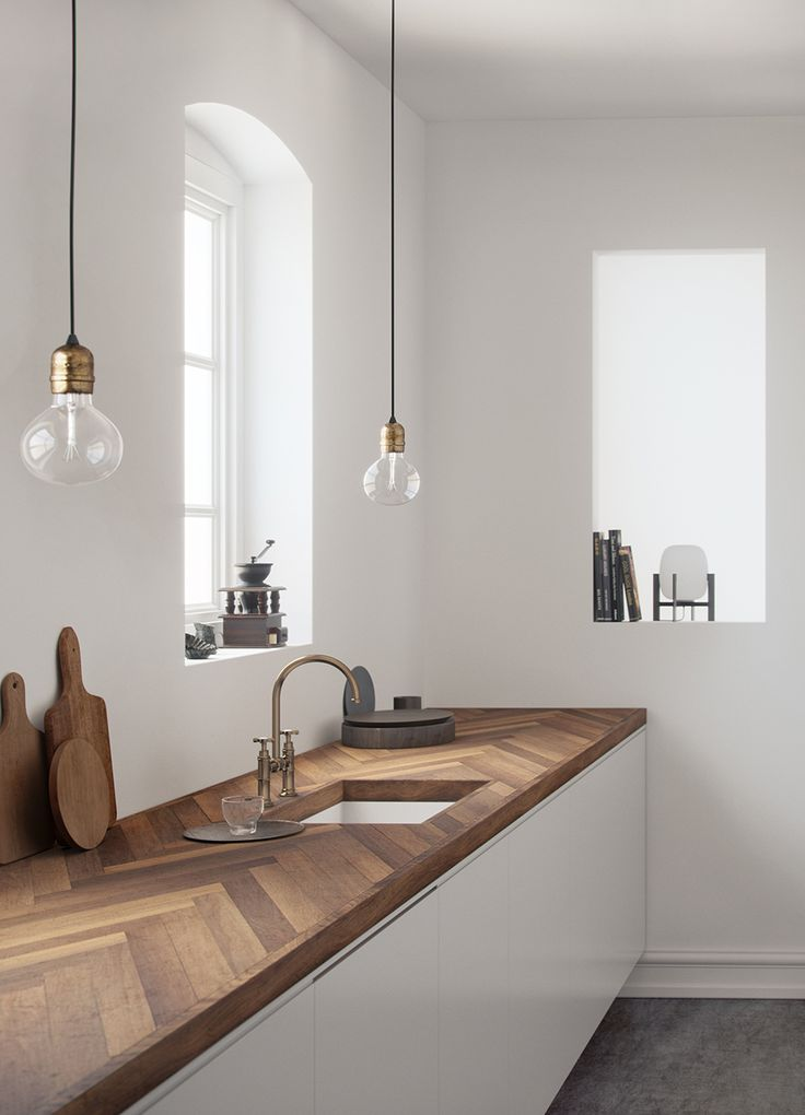 kitchen, grey flor, white wall, glass window, bulb pendants, white cabinet with wooden herringbone sounter top