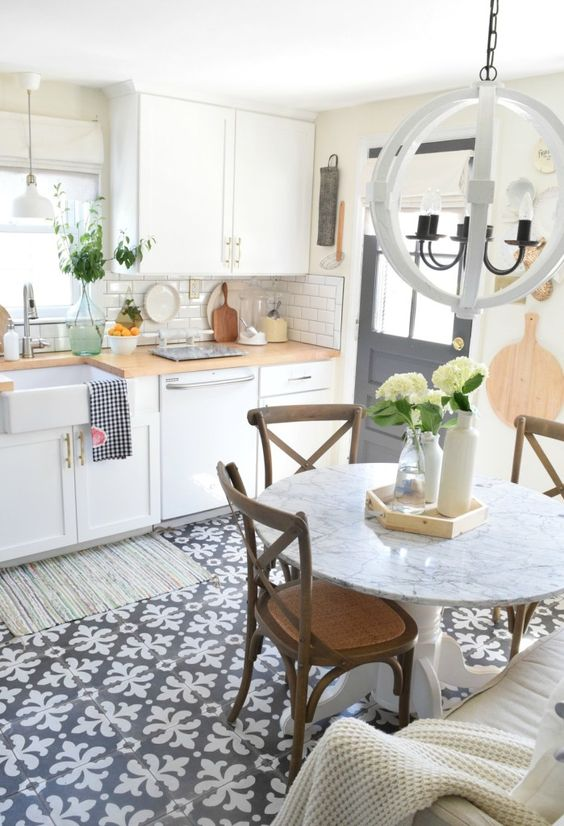 kitchen, patterned floor, white bottom cabinet, window, white pendant,white marble round table, wooden chairs