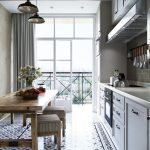 Kitchen, Patterned White Floor, White Wooden Cabinet, Off White Wall, Black Pendant