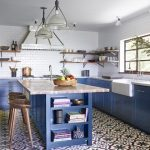 Kitchen, Patterned White Red Floor, White Subway Wall Tiles, White Ceiling, White Pendant, Blue Cabinet, Blue Island, White Marble Counter Top, Wooden Stool