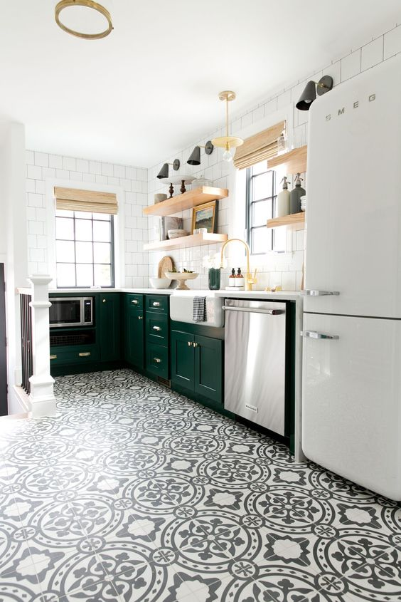 kitchen, white black patterned floo, white square wall tiles, green cabinet, wooden shelves, white fridge, black sconces