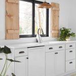 Kitchen, White Bottom Cabinet, White Wall, White Counter Top, Wooden Window, Black Framed Window, Cream Rug