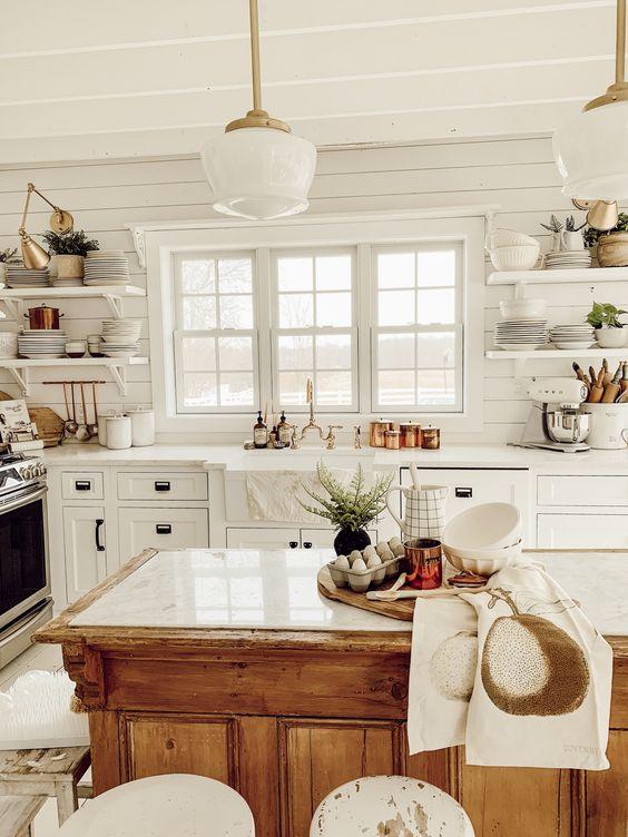kitchen, white floor, white wooden wall planks, white wooden ceiling, white pendant, wooden island with white counter