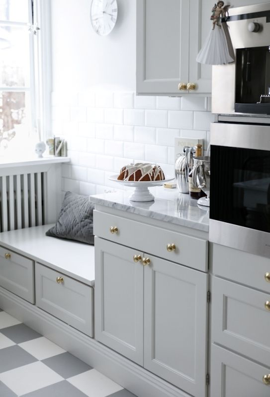kitchen, white grey plaid floor, grey cabinet, white brick backsplash, white wall, grey marble counter top