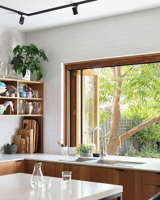 kitchen, wooden bottom cabinet, white wall tiles, wooden framed, glass sliding window, white island, floating shelves
