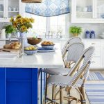 Kitchen, Wooden Floor, Blue Rug, Blue Island, White Marble Counter Top, Rattan Pendants, White Cabinets, Blue Curtain, White Marble Backsplash