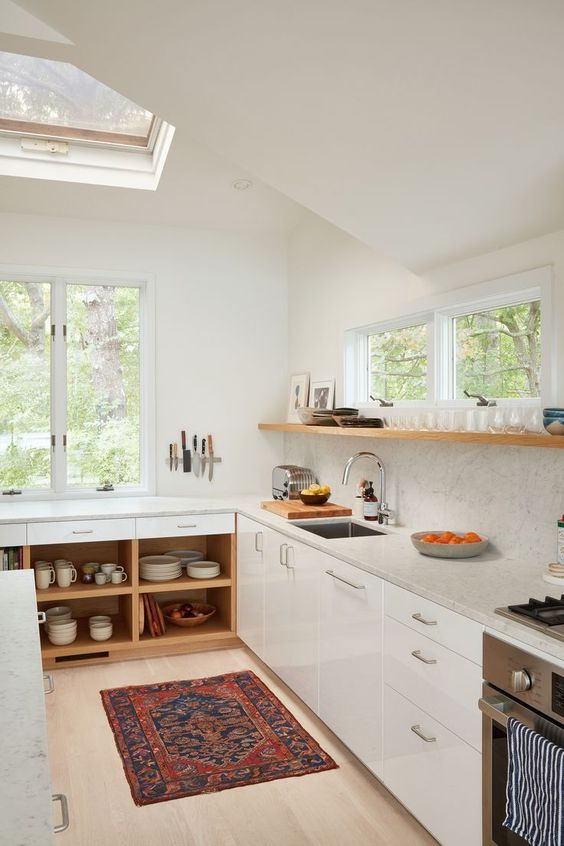 kitchen, wooden floor, white bottom cabinet, white wall, wooden floating shelves, windows