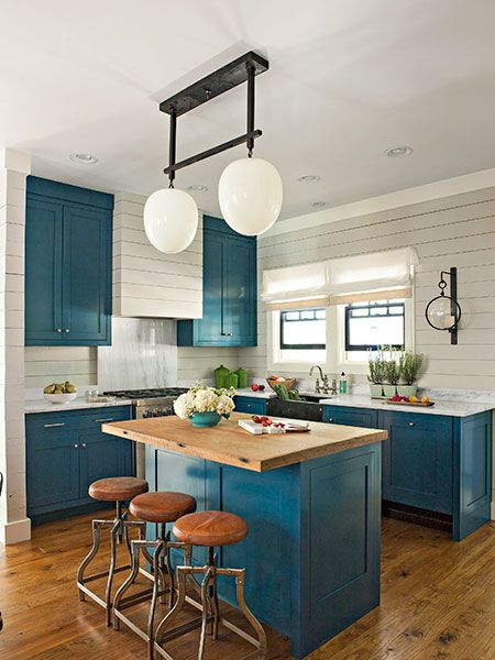 kitchen, wooden floor, white shiplap, blue cabinet with white marble counter top, blue wooden island with wooden counter top