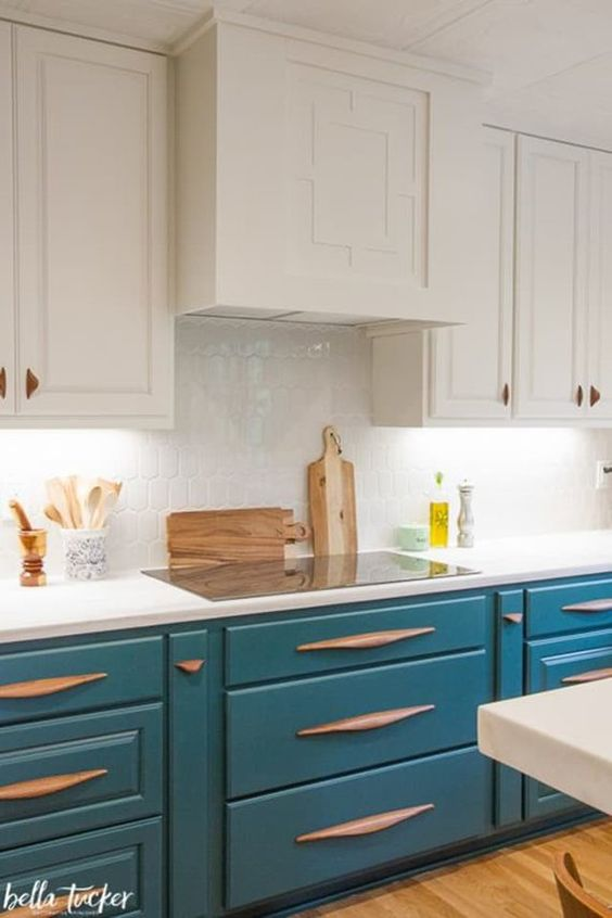 kitchen, wooden floor, white upper cabinet, white backsplash, blue bottom cabinet,