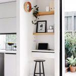 Kitchen, Wooden Floor, White Wall, White Cabinet, White Shades, White Floating Table, Wooden Floating Shelves, Black Stool, Glass Door