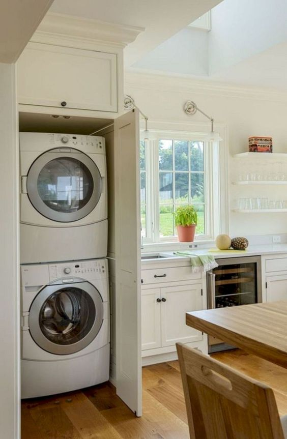 kitchen, wooden floor, white wall, white cabinet, wooden table, white cupboard, white floating shelves