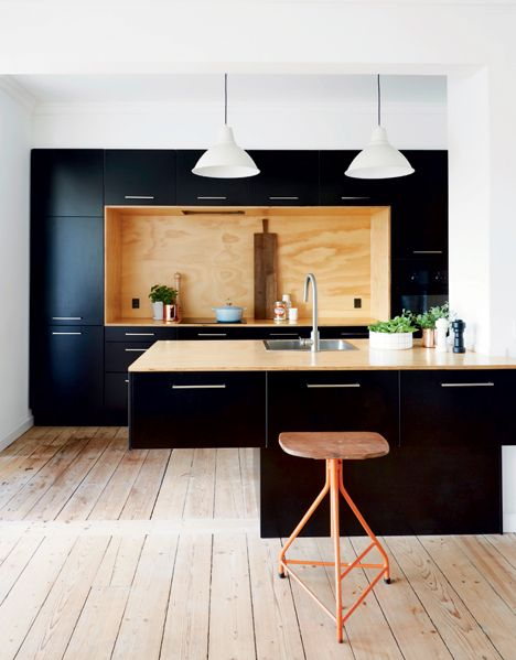 kitchen, wooden floor, white wall, white pendant, black cabinet, black island, wooden stool