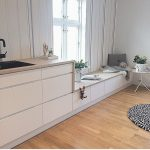 Kitchen, Wooden Floor, Whitecabinet, Wooden Counter Top, Window Seat, White Wall, Side Table