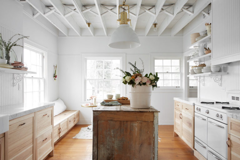 kitchen, wooden floor, wooden bottom cabinet, white marble counter top, white wooden wainscoting, white wall, white wooden ceiling, white pendant