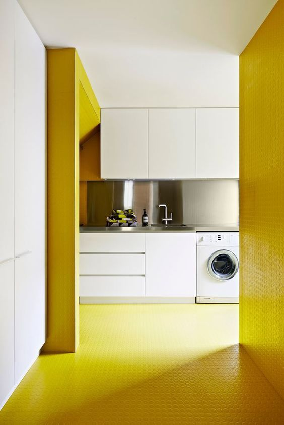 kitchen, yellow rubber floor, white cabinet, silver counter top, white laundry machine