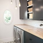 Laundry Room, Patterned Floor, White Wall, White Subway Backsplash, Black Bottom Cabinet, Black Upper Cabinet, Wooden Counter Top, Golden Pendants, Round Window