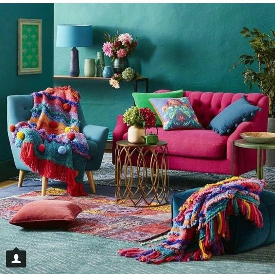 living room, green wall, green rug, green chair, pink sofa, side table, dark gren ottoman