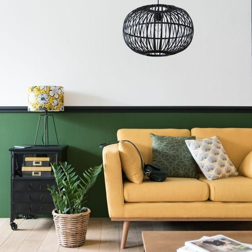 living room, white wall, green bottom wall, wooden floor, yellow sofa, wooden coffee table, black framed pendant