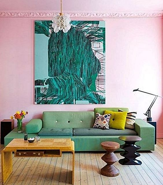 living room, wooden floor, pink wall, green sofa, wooden coffee table, bulbs chandelier