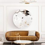 Living Room, Wooden Floor, White Rug, White Round Coffee Table, White Wall, Interesting Chandelier, Golden Sofa, Cream Chairs