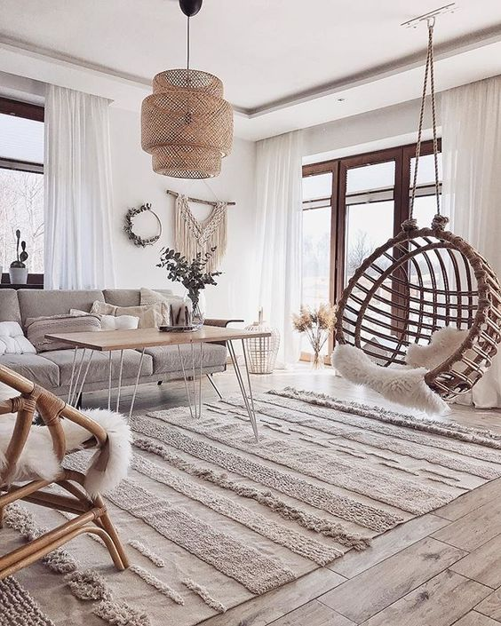 living room, wooden floor, white wall, rattan pendant, rattan swing, grey sofa, wooden coffee table, rattan chairs,