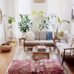 Living Room, Wooden Floor, White Wall, Wooden Chair With Cream Cushion, Rattan Pendant, Pink Ottomans, Brown Rug,