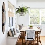 Nook, Wooden Floor, White Wall, White Bench With White Cushion, Wooden Table, Rattan Chairs, Hanging Plants