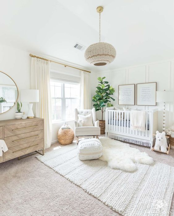 nursery, white rug, white rug floor, white wall, white crib, white chair, wooden cabinet, round mirror, white lamps